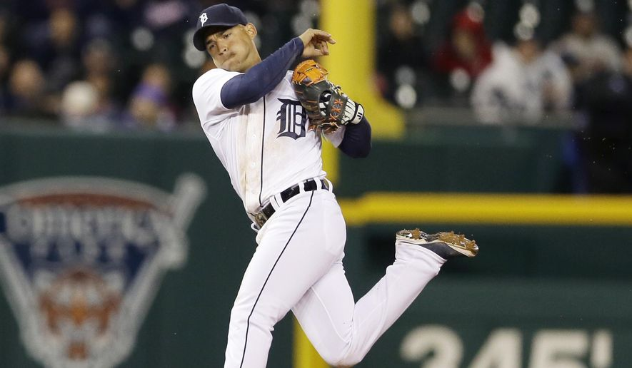 Detroit Tigers shortstop Jose Iglesias throws out New York Yankees' Brett Gardner during the sixth inning of a baseball game, Monday, April 20, 2015, in Detroit. (AP Photo/Carlos Osorio)