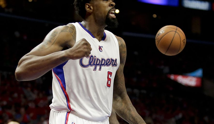 Los Angeles Clippers center DeAndre Jordan celebrates against the San Antonio Spurs during the first half of Game 1 of a first-round NBA basketball  playoff series in Los Angeles, Sunday, April 19, 2015. (AP Photo/Chris Carlson)