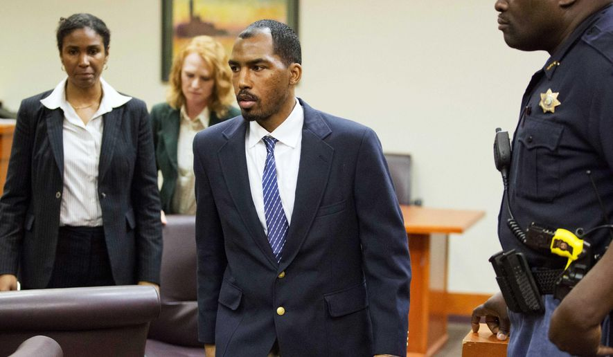 Aeman Presley walks out of DeKalb County Superior Court after his first appearance to face charges including malice murder, felony murder and aggravated assault in the deaths of 44-year-old Karen Pearce and 53-year-old Calvin Gholston, Monday, April 20, 2015, in Decatur, Ga. Presley, 34, also faces charges including murder in the killings of two homeless men in Atlanta. The Fulton County and DeKalb County district attorneys have both said they intend to seek the death penalty against him. (AP Photo/David Goldman)