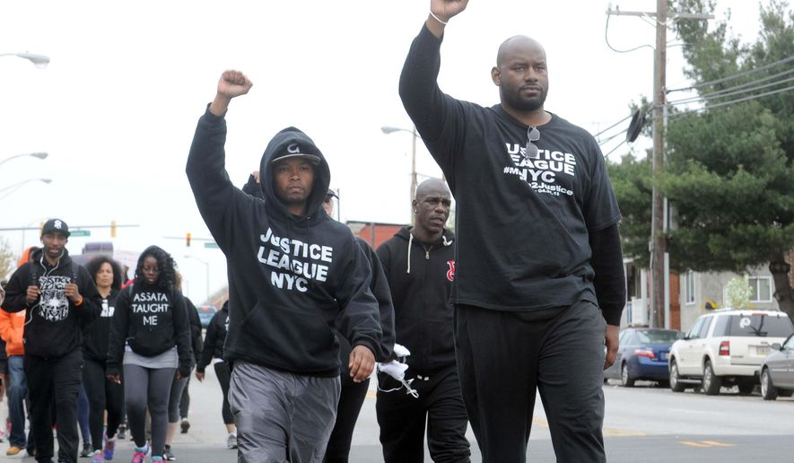 Citizens and groups such as the Justice League of NYC protest against the police following the death of Freddie Gray, Sunday, April 19, 2015, in Baltimore. Gray, 25, of Baltimore, died Sunday at a hospital, a week after he was hurt following an arrest. (Algerina Perna/The Baltimore Sun via AP)  WASHINGTON EXAMINER OUT