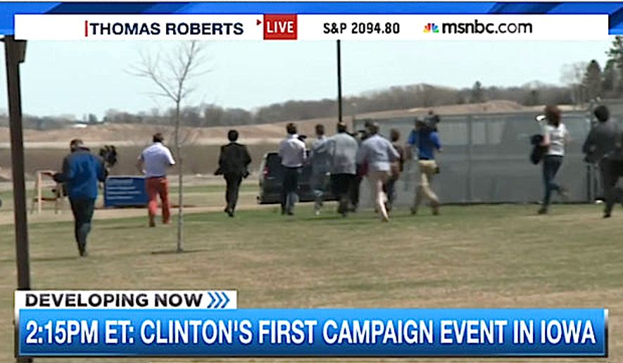 Reporters race after Hillary Clinton's van during her first campaign stop in Iowa. (MSNBC)