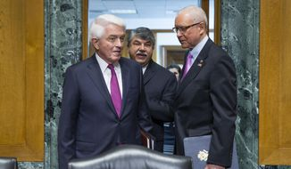 Senate Finance Committee Chairman Sen. Orrin Hatch, R-Utah, right, walks into a hearing room on Capitol Hill in Washington, Tuesday, April 21, 2015, with AFL-CIO president Richard Trumka, center, and U.S. Chamber of Commerce President Tom Donohue before the committee's hearing on fast track authority. (AP Photo/Evan Vucci) ** FILE **