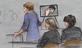 In this courtroom sketch, prosecutor Nadine Pellegrini makes opening arguments during the first day of the penalty phase in the trial of Boston Marathon bomber Dzhokhar Tsarnaev, seated at right, Tuesday, April 21, 2015, in federal court in Boston. Pellegrini displayed a photo to the jury of Tsarnaev extending his middle finger to a security camera taken in his jail cell three months after the attack. (AP Photo/Jane Flavell Collins)