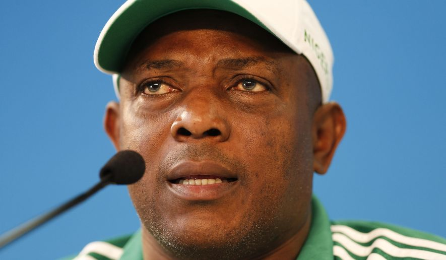FILE - A Tuesday, June 24, 2014 photo from files showing Nigeria's soccer coach, Stephen Keshi, speaking during a news conference at Beira-Rio Stadium in Porto Alegre, Brazil. The Nigerian Football Federation said Tuesday, April 21, 2015 that Stephen Keshi had signed a new two-year contract as head coach of the national team. (AP Photo/Victor R. Caivano, File)