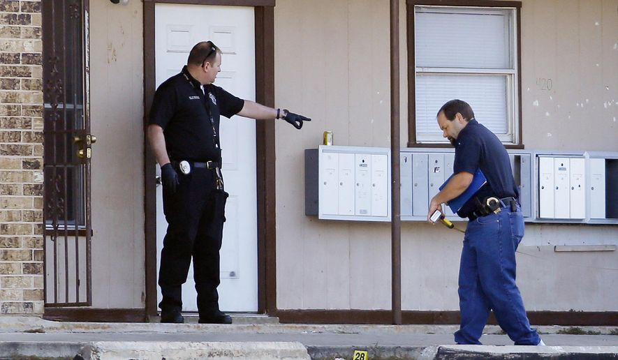 The Killeen Police Department investigates a shooting, which left two people dead and three wounded, at the Village West Apartments in Killeen, Texas on Tuesday morning, April 21, 2015. The remaining three victims were transported to two area hospitals, and their condition is unknown. (Eric J. Shelton/The Killeen Daily Herald via AP)