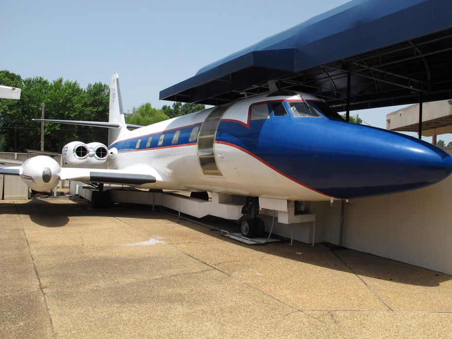 FILE - This July 1, 2014, file photo shows the Hound Dog II, one of two jets once owned by late singer Elvis Presley on display at Graceland in Memphis, Tenn. Lisa Marie and the Hound Dog II, will be moved from Graceland to a location down the street under a plan approved Tuesday, April 21, 2015, by the Memphis City Council. (AP Photo/Adrian Sainz, File)