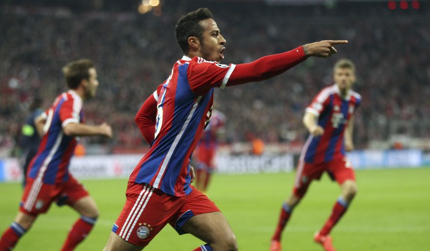 Bayern's Thiago celebrates his team's goal during the soccer Champions League quarterfinal second leg match between Bayern Munich and FC Porto at the Allianz Arena in Munich, southern Germany, Tuesday, April 21, 2015. (AP Photo/Michael Probst)
