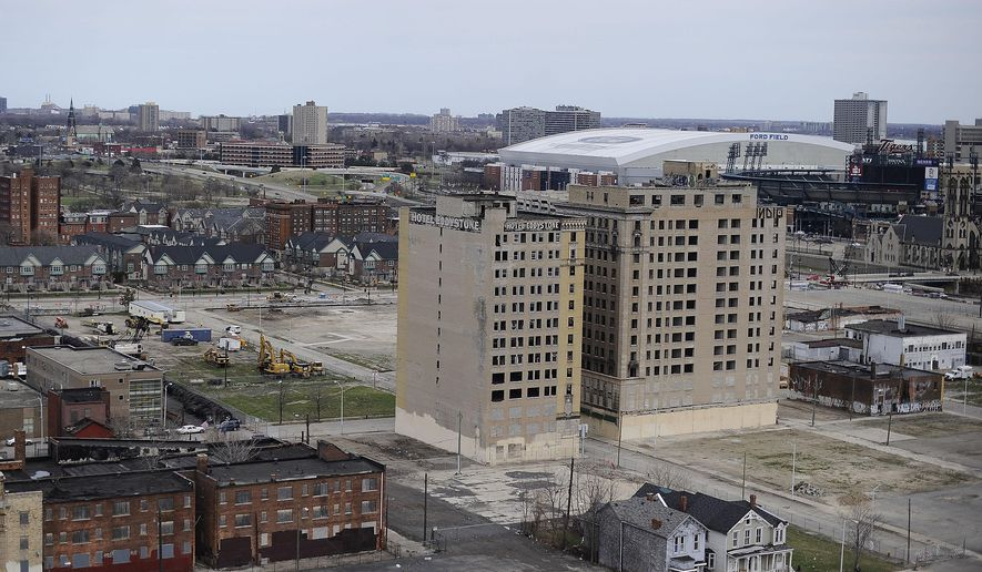 RETRANSMISSION TO CORRECT CONTEXT OF CAPTION  - A Tuesday, April 14, 2015 photo shows the location of the proposed new hockey stadium around the Cass Corridor area in Detroit.  The fate of two empty, vandalized buildings in Detroit's Cass Corridor has become a major stumbling block in the plan to start building a $450 million arena for the Detroit Red Wings. The Detroit City Council is expected to discuss the matter Tuesday, April 21, 2015.  (Elizabeth Conley/Detroit News via AP)  DETROIT FREE PRESS OUT; HUFFINGTON POST OUT