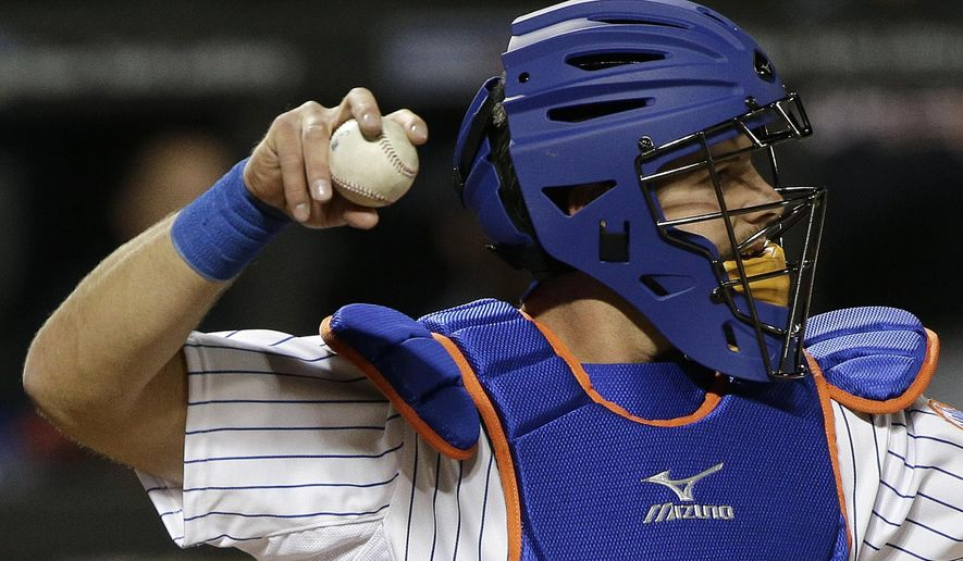 New York Mets catcher Kevin Plawecki throws back to the mound during the seventh inning of the Mets' baseball game against the Atlanta Braves, Tuesday, April 21, 2015, in New York. (AP Photo/Julie Jacobson)