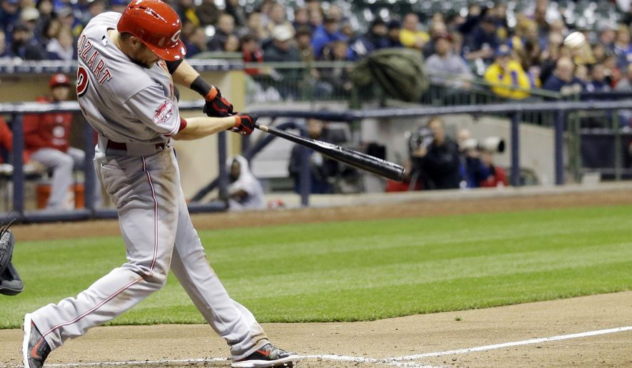 Cincinnati Reds' Zack Cozart hits a two-run home run during the fifth inning of a baseball game against the Milwaukee Brewers on Tuesday, April 21, 2015, in Milwaukee. (AP Photo/Morry Gash)