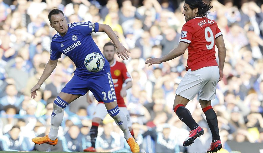 Chelsea's John Terry, left, challenges for the ball with Manchester United's Radamel Falcao during the English Premier League soccer match between Chelsea and Manchester United at Stamford Bridge stadium in London, Saturday, April 18, 2015. (AP Photo/Kirsty Wigglesworth)