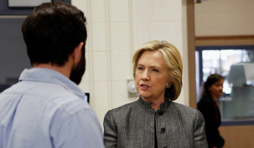 Hillary Rodham Clinton speaks to student Travis Lemieux during a campaign stop at New Hampshire Technical Institute on Tuesday. (Associated Press)