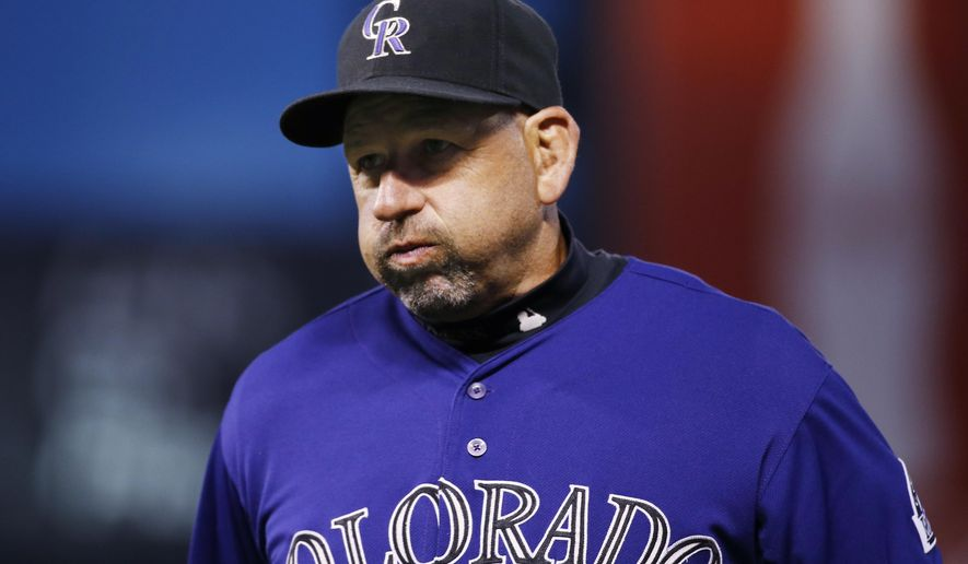 Colorado Rockies manager Walt Weiss reacts to the teams performance during a baseball game against the San Diego Padres Monday, April 20, 2015, in Denver. (AP Photo/Jack Dempsey)