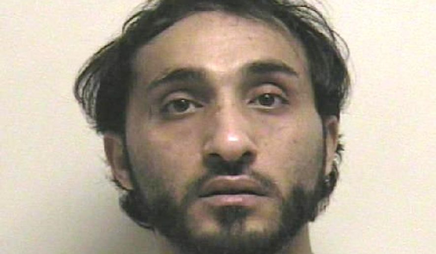This photo released by Utah County Jail shows Monsour Alshammari. A Utah judge has ordered that the Saudi Arabian man facing rape charges be jailed without bail because authorities believe he's trying to flee the country. A judge issued the warrant Monday, April 20, 2015, for 27-year-old Alshammari after a request from police in Orem. (Utah County Jail via AP)