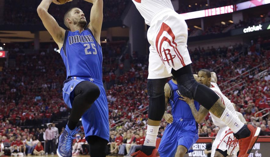 Dallas Mavericks' Chandler Parsons (25) is defended by Houston Rockets' Josh Smith (5) as he looks to score during the first quarter of game 1 in the first round of the NBA basketball playoffs Saturday, April 18, 2015, in Houston. (AP Photo/David J. Phillip)