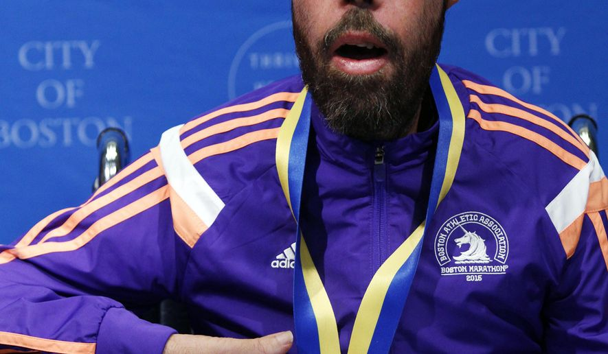 Maickel Melamed, of Venezuela, the last participant to finish this year's Boston Marathon, speaks after receiving a medal from Boston Mayor Marty Walsh during a ceremony, Tuesday, April 21, 2015, in Boston. Melamed, 39, has a form of muscular dystrophy which severely impairs his mobility. He crossed the finish line about 20 hours after he started. (AP Photo/Bill Sikes)