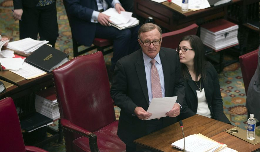 Sen. John DeFrancisco, R-Syracuse, speaks in the Senate Chamber at the Capitol, Tuesday, April 21, 2015, in Albany, N.Y. Republican lawmakers are backing Senate Leader Dean Skelos amid a federal investigation into whether he influenced Nassau County's decision to award a $12 million contract to a company that hired his son. (AP Photo/Mike Groll)