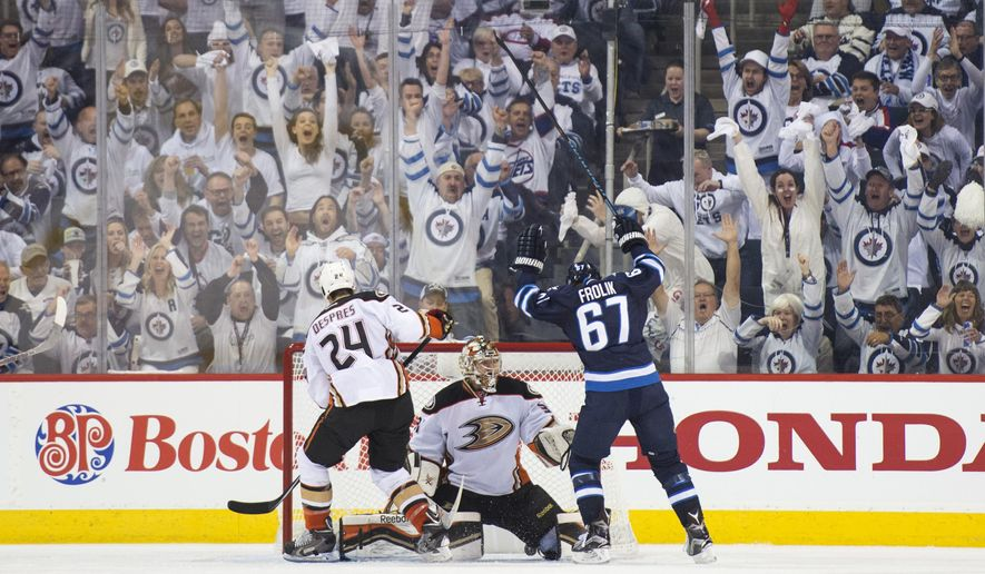 Winnipeg Jets right wing Michael Frolik (67) scores against Anaheim Ducks goalie Frederik Andersen (31) during the second period of Game 3 of the opening round of the Stanley Cup NHL hockey playoffs, Monday, April 20, 2015, in Winnipeg, Manitoba. Anaheim defeated Winnipeg 5-4 in overtime, taking a 3-0 series lead. (Michael Goulding/The Orange County Register via AP)