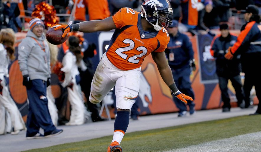 FILE - In this Dec. 28, 2014, file photo, Denver Broncos running back C.J. Anderson celebrates his touchdown against the Oakland Raiders during the second half of an NFL football game in Denver. The third-year pro burst onto the NFL scene last season, earning a Pro Bowl invitation after rushing for 849 yards and eight TDs despite not starting until Nov. 16.  (AP Photo/Jack Dempsey, File)