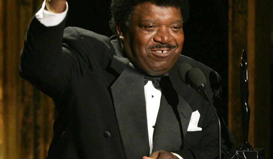 "FILE - In this March 14, 2005 file photo, Percy Sledge accepts his award during the Rock and Roll Hall of Fame induction ceremony in New York. Sledge was remembered for phenomenal talent and extraordinary kindness during a funeral service on Tuesday, April 21, 2015, in Baker, La. Sledge, who recorded the classic 1966 soul ballad ""When a Man Loves a Woman,"" died, April 14, at the age of 74. (AP Photo/Julie Jacobson, File)"
