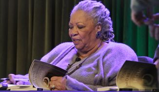 "In this Feb. 27, 2013 file photo, author Toni Morrison signs copies of her latest book ""Home,"" during Google's online program series, Authors At Google, in New York. Morrison's latest book, ""God Help the Child,"" will be released on Tuesday, April 21, 2015.  (AP Photo/Bebeto Matthews, File)"