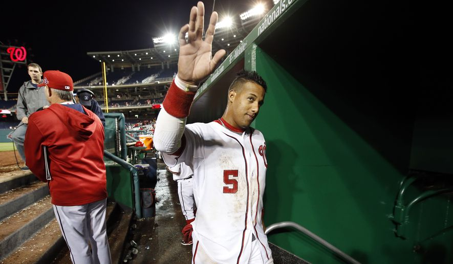 Washington Nationals' Yunel Escobar waves to the fans as he heads to the clubhouse after his game winning solo home run in the 10th inning of a baseball game against the St. Louis Cardinals at Nationals Park, Tuesday, April 21, 2015, in Washington. The Nationals won 2-1, in 10 innings. (AP Photo/Alex Brandon)