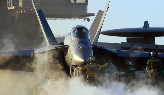 An F/A-18E Super Hornet assigned to the Eagles of Strike Fighter Squadron (VFA) 115 is prepared for take-off from the aircraft carrier USS George Washington (CVN 73).  U.S. Navy photo.