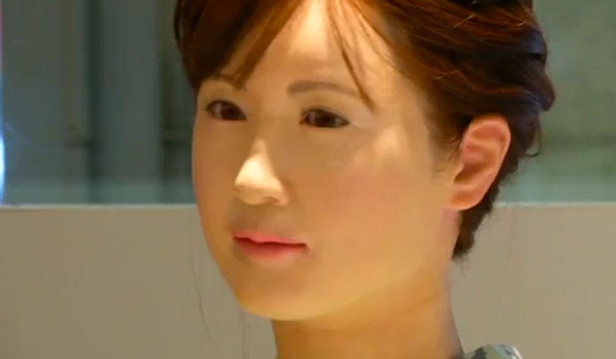 Tokyo's Mitsukoshi department store uses a life-like humanoid robot to greet and interact with store customers. (Image: NBC News screenshot)