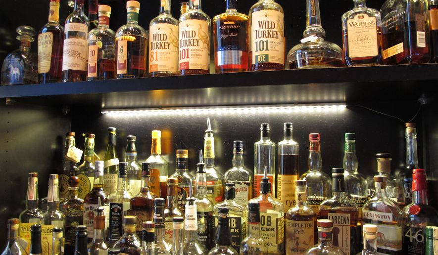 This Sept. 5, 2014, photo shows Sidebar at Whiskey Row, a bar that offers more than 100 bourbons, in the heart of downtown Louisville, Ky. Restaurants along the city's Urban Bourbon Trail are routinely stocked with 50 to 150 varieties of Kentucky's signature spirit. (Associated Press) **FILE**