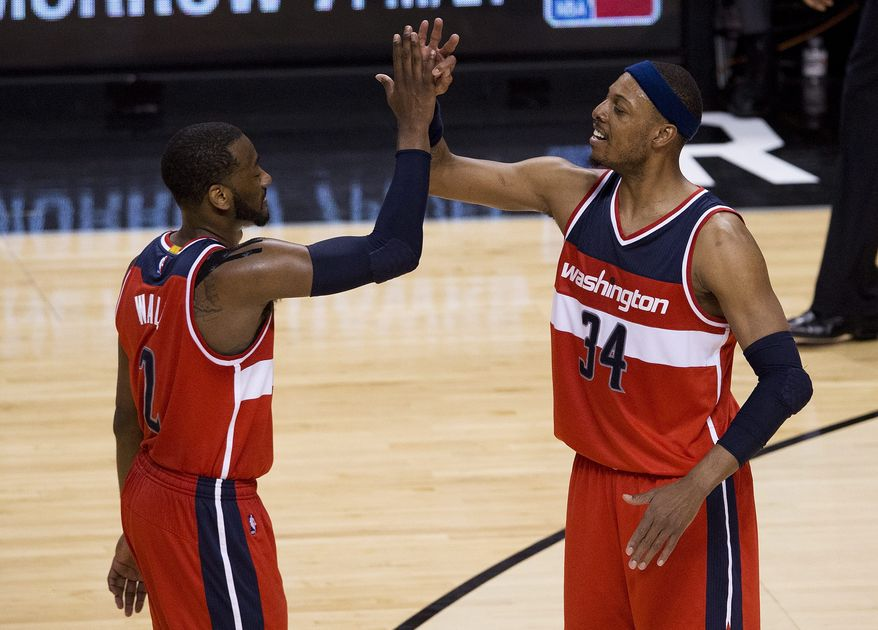 Washington Wizards forward Paul Pierce (34) celebrates with Washington Wizards guard John Wall (2) in the final seconds during the second half in Game 2 in the first round of the NBA basketball playoffs, Tuesday, April 21, 2015,  in Toronto. (Nathan Denette/The Canadian Press via AP)  MANDATORY CREDIT