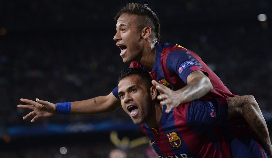Barcelona's Neymar celebrates on the shoulders of teammate Dani Alves, after scoring his second goal during the Champions League quarterfinal second leg soccer match between FC Barcelona and Paris Saint Germain at the Camp Nou Stadium in Barcelona, Spain, Tuesday, April 21, 2015. (AP Photo/Manu Fernandez)