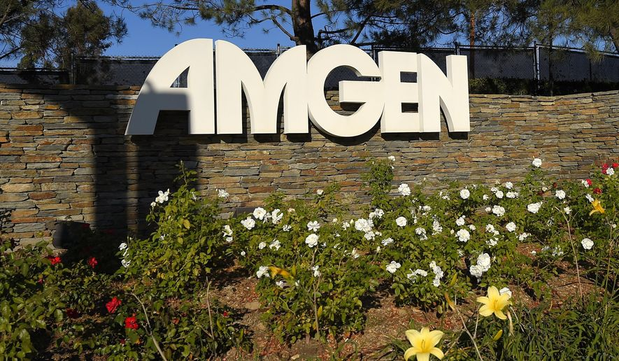 FILE - This Nov. 9, 2014 file photo shows signage at the entrance to Amgen offices in Thousand Oaks, Calif. Amgen Inc. boosted first-quarter profit by 51 percent, thanks to surging sales of its top prescription drugs and ongoing cost cuts designed to free up cash to mount an unprecedented spurt of new product launches. The huge biologic drugmaker on Tuesday, April 21, 2015,  edged out Wall Street forecasts and boosted its profit forecast for 2015 a bit.  (AP Photo/Mark J. Terrill, File)