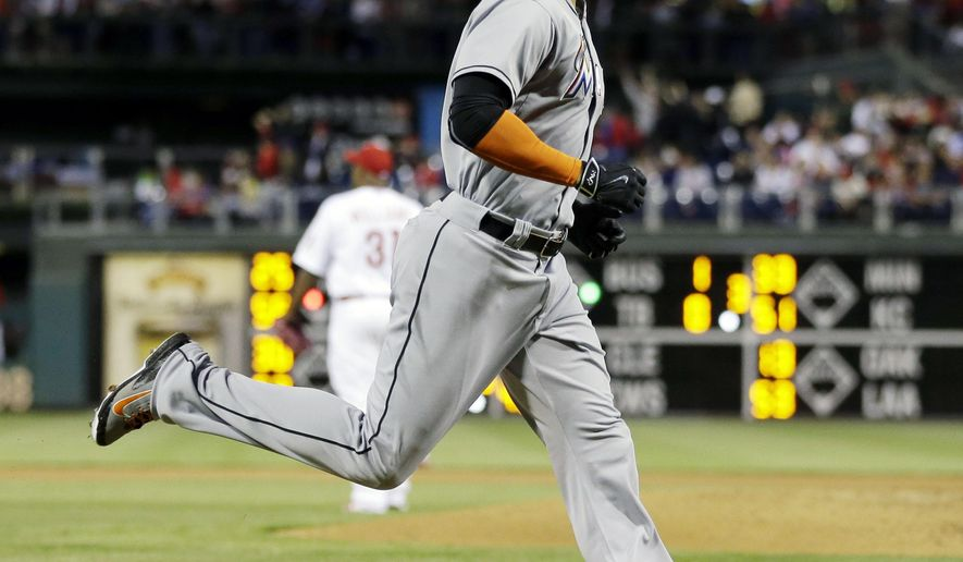 Miami Marlins' Giancarlo Stanton, right, rounds the bases after hitting a home run off Philadelphia Phillies starting pitcher Jerome Williams during the fourth inning of a baseball game, Tuesday, April 21, 2015, in Philadelphia. (AP Photo/Matt Slocum)
