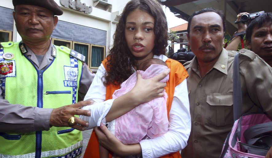 Heather Mack of Chicago, Ill., center, carries her baby daughter as she arrives at the Denpasar District Court before her verdict trial in Bali, Indonesia, Tuesday, April 21, 2015. Indonesian prosecutors want jail sentences of 18 years for her boyfriend Tommy Schaefe and 15 years for Mack if they are found guilty of murdering Sheila von Wiese-Mack, 62, whose badly beaten body was found in a suitcase in the trunk of a taxi outside an upscale hotel in August 2014 on the resort island of Bali. (AP Photo/Firdia Lisnawati)