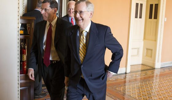 Senate Majority Leader Mitch McConnell, R- Ky., right, walks with Sen. John Barrasso, R-Wyo., left, and Senate Majority Whip John Cornyn of Texas, center, to a news conference on Capitol Hill in Washington, Tuesday, April 21, 2015. Republican and Democratic lawmakers talked about putting the final touches on a human trafficking bill, and turning their attention to Attorney General nominee Loretta Lynch. (AP Photo/Evan Vucci)