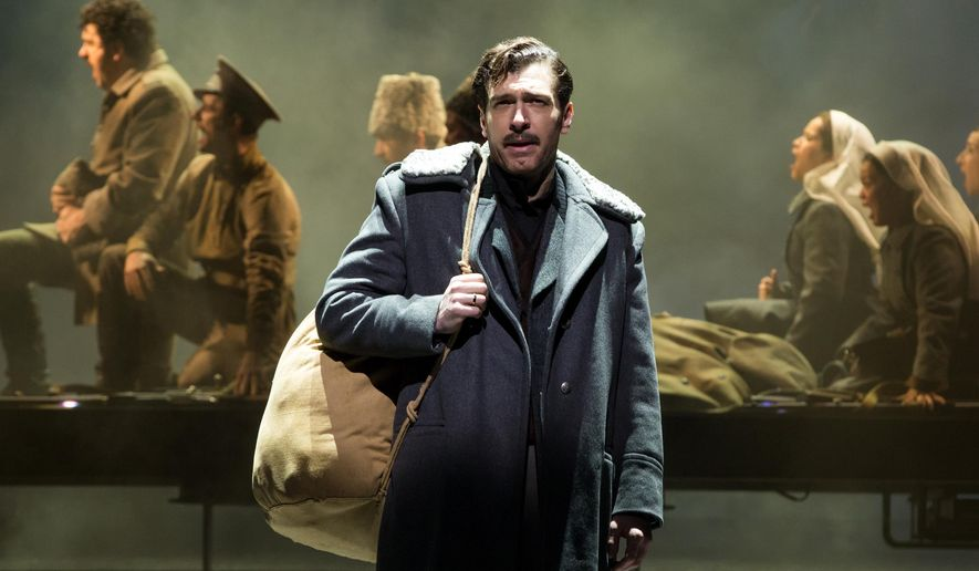 "This image released by Polk & Co. shows Tam Mutu during a performance of  the Broadway musical, ""Doctor Zhivago,"" in New York. (Matthew Murphy/Polk & Co. via AP)"