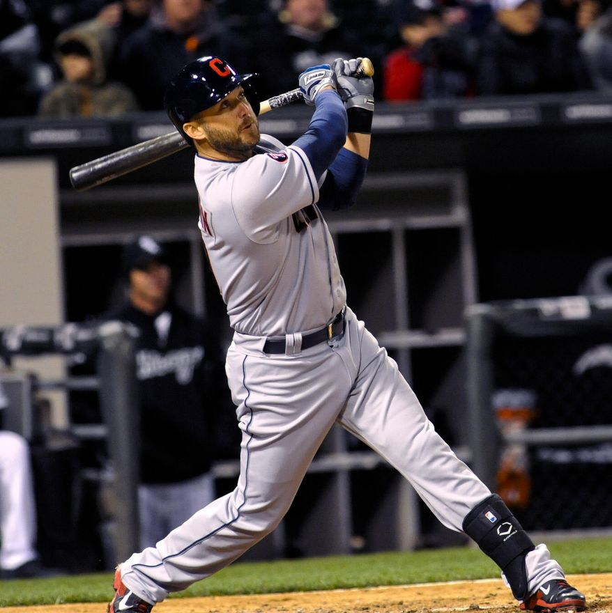 Cleveland Indians designated hitter Ryan Raburn doubles against the Chicago White Sox in the sixth inning of an baseball game on Monday, May 20, 2015, in Chicago. (AP Photo/Matt Marton)