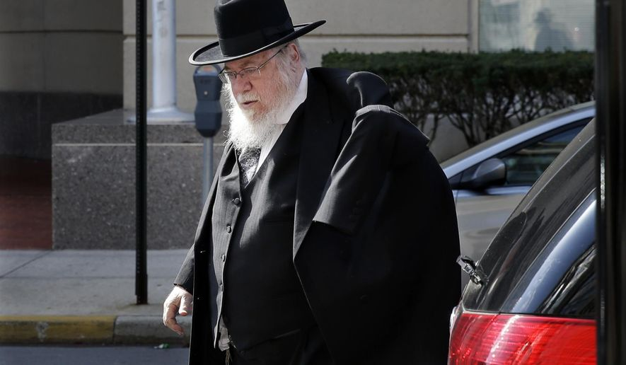 Rabbi Mendel Epstein, 69, arrives at federal court as the jury deliberations continue into the third day in his case Tuesday, April 21, 2015, in Trenton, N.J.  The Orthodox rabbi is accused of using brutal tactics to force unwilling Jewish men to divorce their wives. Rabbi Epstein faces charges of conspiracy to commit kidnapping and attempted kidnapping with his son and two other Orthodox rabbis. Prosecutors say the rabbi's team used brutal methods and tools, including handcuffs and electric cattle prods, to torture the men into granting divorces. (AP Photo/Mel Evans)