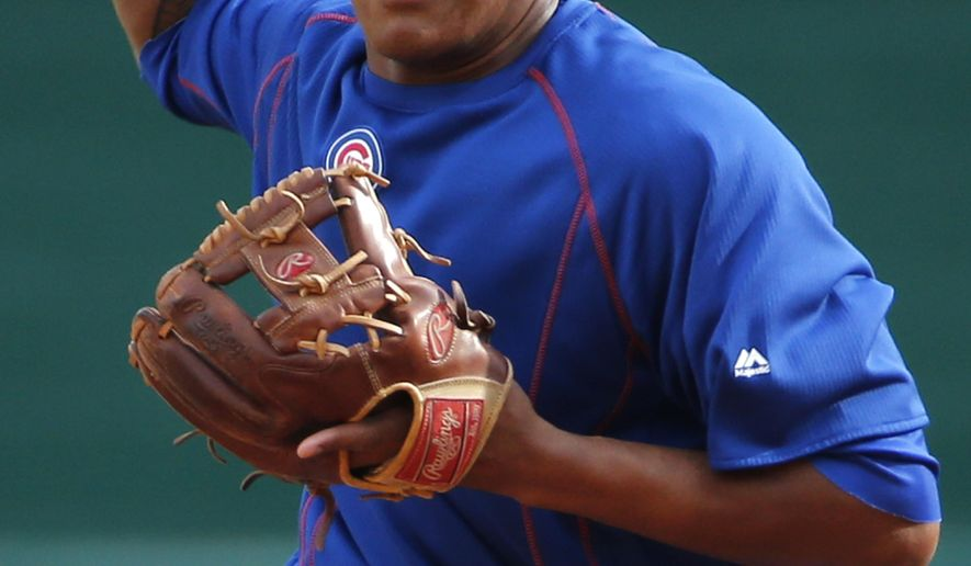 Chicago Cubs second baseman Addison Russell fields ground balls before a baseball game against the Pittsburgh Pirates in Pittsburgh, Tuesday, April 21, 2015. Russell is in tonight's lineup, playing second and batting ninth. (AP Photo/Gene J. Puskar)