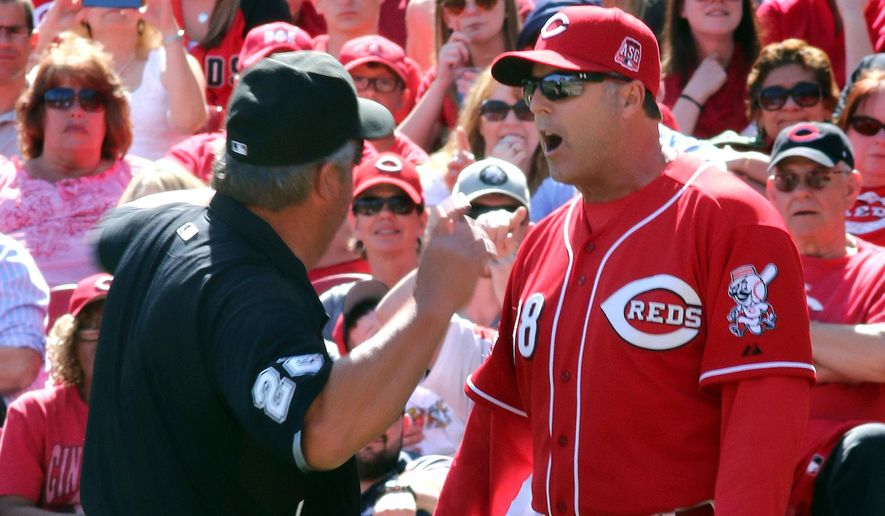 In this Sunday, April 12, 2015, file photo, Cincinnati Reds manager Bryan Price is ejected by umpire Joe West while arguing a call against the St. Louis Cardinals in the seventh inning of a baseball game, in Cincinnati. Price went on a profanity-filled rant during his pregame meeting with media, Monday, April 20, 2015, taking exception with the way his team was being covered. (AP Photo/Tom Uhlman, File)