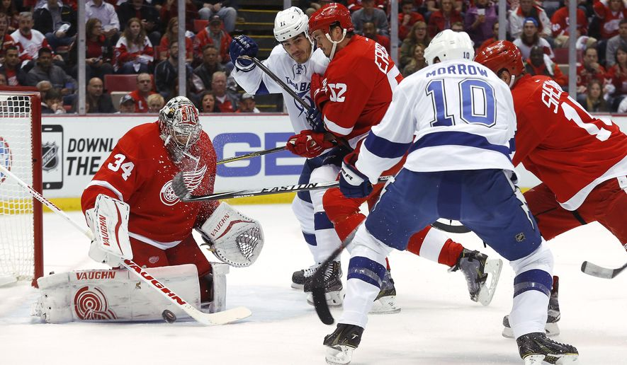 Detroit Red Wings goalie Petr Mrazek (34) stops a Tampa Bay Lightning left wing Brenden Morrow (10) shot during the first period of Game 3 of a first-round NHL Stanley Cup hockey playoff series  in Detroit Tuesday, April 21, 2015. (AP Photo/Paul Sancya)