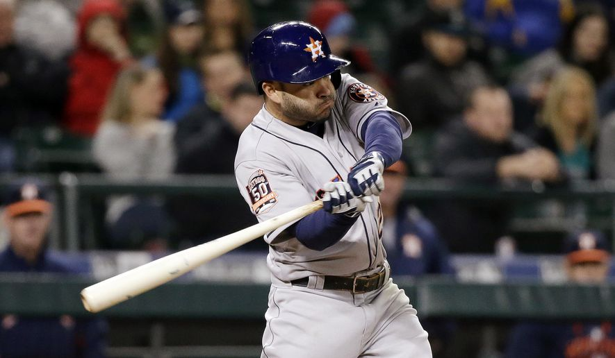 Houston Astros' Jose Altuve doubles in three runs against the Seattle Mariners in the eighth inning of a baseball game Tuesday, April 21, 2015, in Seattle. (AP Photo/Elaine Thompson)