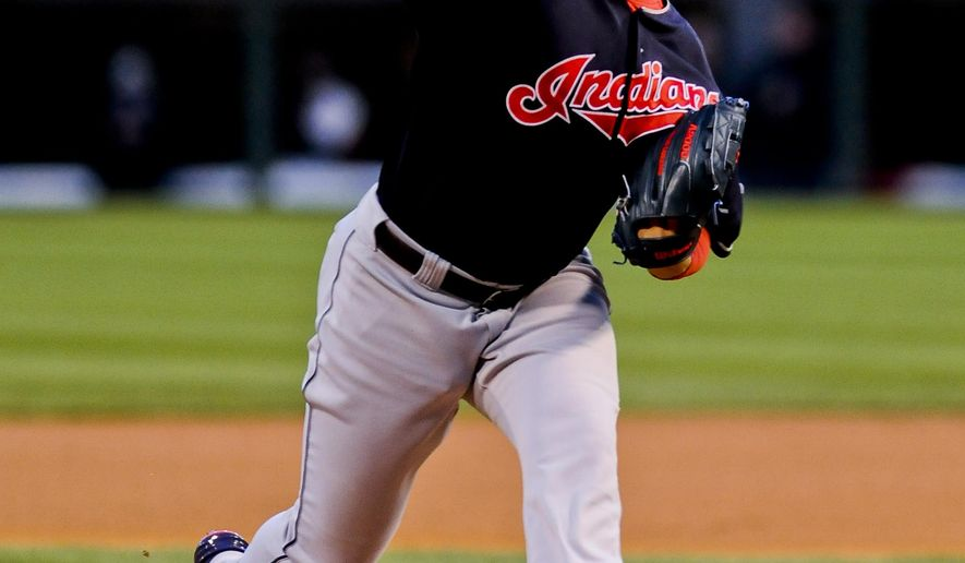 Cleveland Indians starting pitcher Carlos Carrasco delivers in the first inning of a baseball game against the Cleveland Indians on Tuesday, April 21, 2015, in Chicago. (AP Photo/Matt Marton)