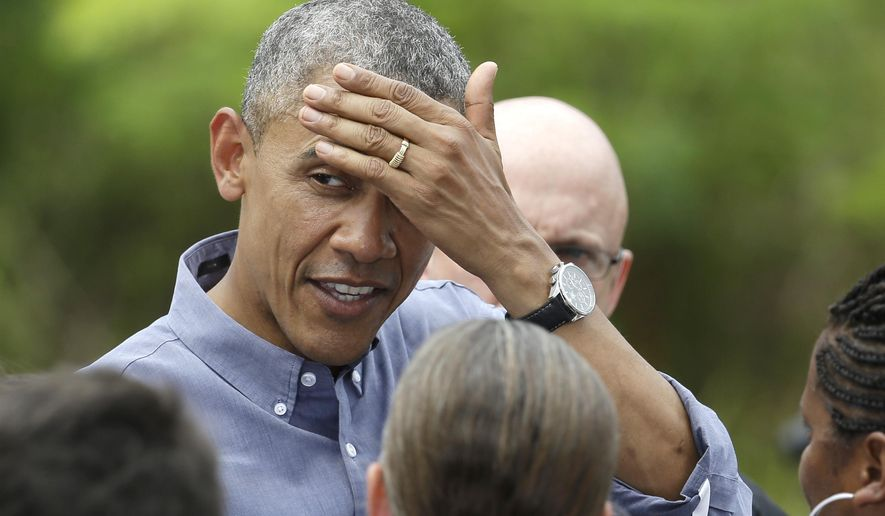 President Obama wipes his forehead April 22, 2015, while meeting with the crowd after touring Everglades National Park in Florida on Earth Day. Obama used the visit to warn of the damage that climate change is already inflicting on the nation's environmental treasures. (Associated Press) **FILE**