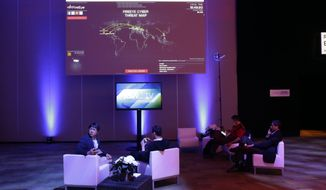 A cyber security threat map is displayed inside a lounge during the RSA Conference on Wednesday, April 22, 2015, in San Francisco. Threat analysts, security vendors and corporate IT administrators have gathered here to talk about malicious software, spear-phishing and other attacks that can steal money or secrets from companies and consumers. (AP Photo/Marcio Jose Sanchez)
