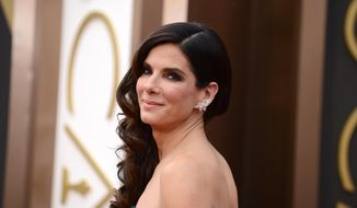 "FILE - In this March 2, 2014, file photo, Sandra Bullock arrives at the Oscars at the Dolby Theatre, in Los Angeles. People magazine has named Bullock as the ""World's Most Beautiful Woman"" for 2015, the magazine announced, Wednesday, April 22, 2015. (Photo by Jordan Strauss/Invision/AP, File)"