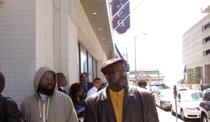 Ronald Roberts, right, waits at the head of the line of applicants for jobs at the Chelsea hotel in Atlantic City N.J. on Wednesday April 22, 2015. Roberts lost his cook's job last August when the Showboat casino closed.  Many laid-off casino workers were among those seeking jobs at the Chelsea.  Chelsea owner Curtis Bashaw said most of the positions are seasonal summer jobs, but added some of the best hires will be kept on permanently.   (AP Photo/Wayne Parry)