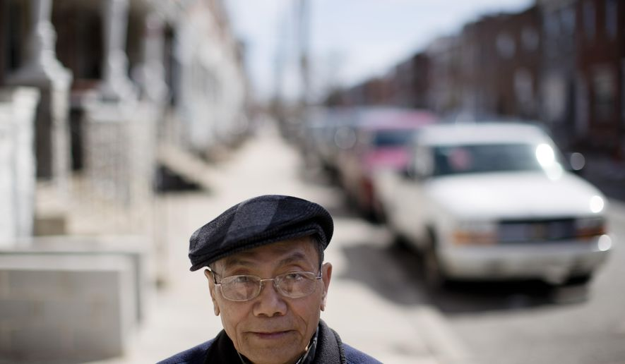 In this Thursday, April 16, 2015 photo, Vietnamese American Catholic Ly Nguyen poses for a photograph outside of his home in Philadelphia.  Nguyen and his family moved to Philadelphia from Vietnam more than 20 years ago and was welcomed and helped by the local Catholic church. (AP Photo/Matt Rourke)