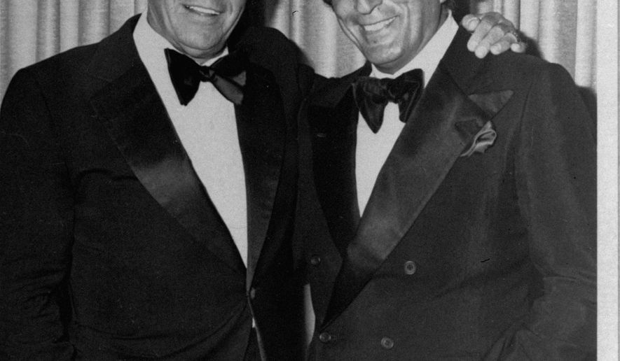 "FILE - In this July 1980 file photo, Frank Sinatra, left,  poses with Tony Bennett  in Reno, Nev.   ""He changed my whole career,"" the 88-year-old Bennett said of Sinatra at the Tribeca Film Festival tribute on Tuesday, April 21, 2015, part of a yearlong Sinatra centennial celebration that also included a screening of the digitally restored Sinatra-Gene Kelly favorite and love letter to New York ""On the Town.""  (AP Photo/FILE)"