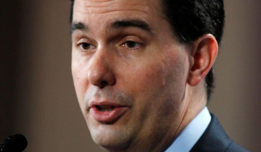 Wisconsin Gov. Scott Walker broke from the GOP by saying that there should be limits on how many legal immigrants should be allowed to enter the U.S. (Associated Press)
